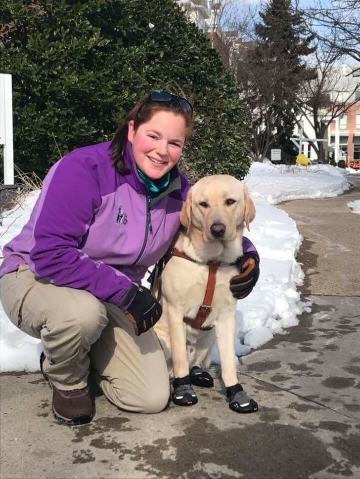 Seeing Eye instructor with a yellow Lab.