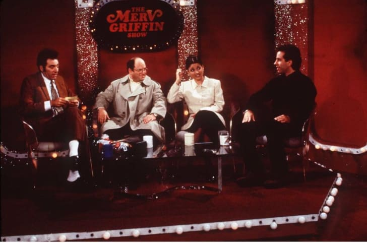 Michael Richards, Jason Alexander, Julia Louis-Dreyfus, and Jerry Seinfeld in a scene from Seinfeld.