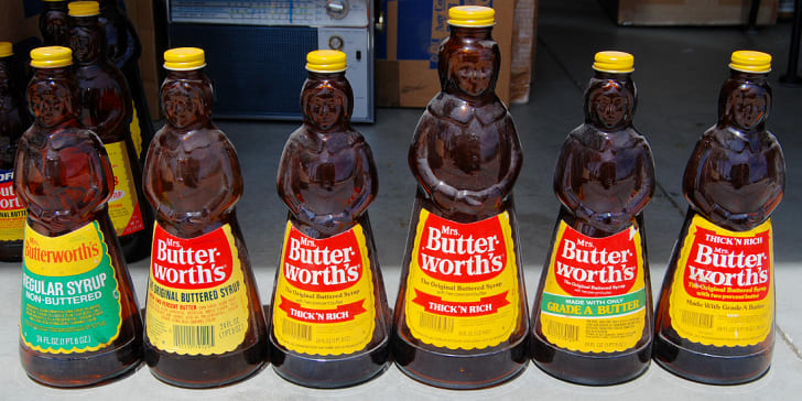 Several containers of 1970s-style Mrs. Butterworth's syrup