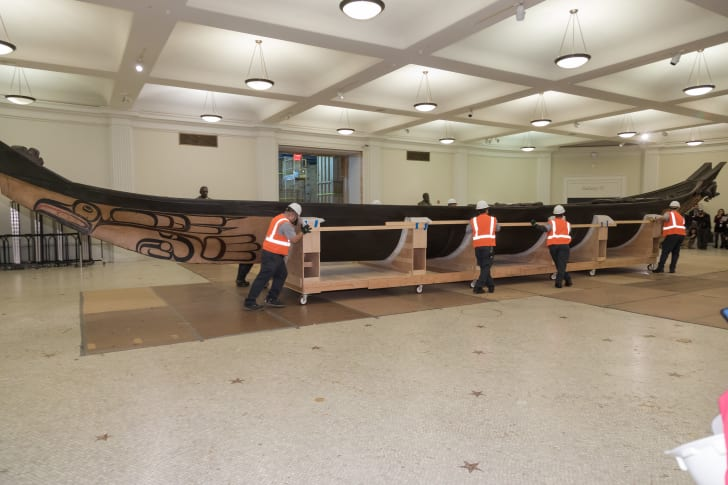 Moving the Great Canoe at the American Museum of Natural History in New York.