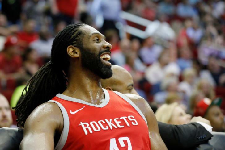 Nene Hilario #42 of the Houston Rockets reacts on the bench during the second half against the Washington Wizards at Toyota Center on April 3, 2018 in Houston, Texas