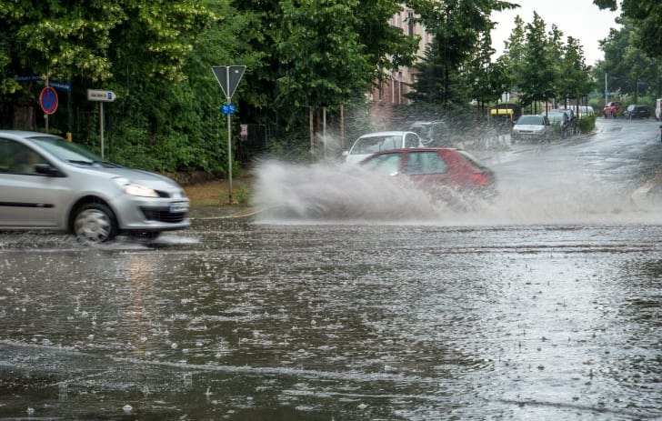 Flooded street with splashing cars