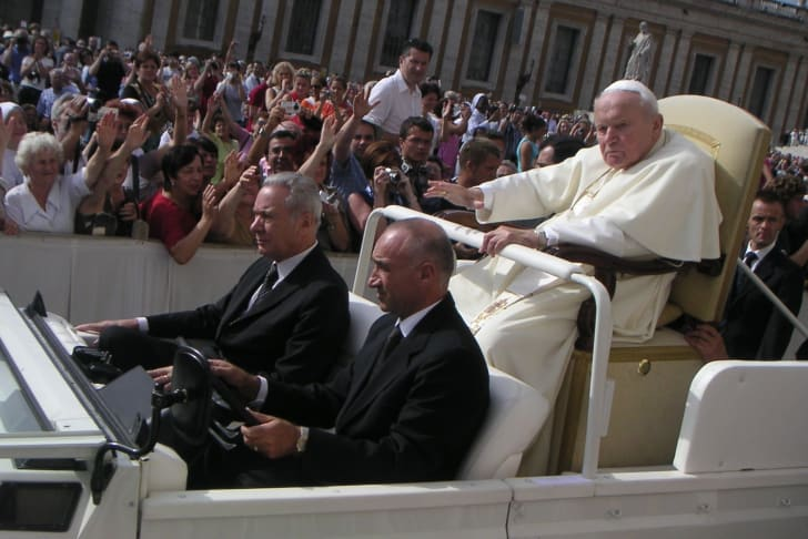 Pope John Paul II riding in the Popemobile