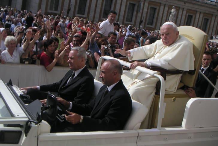 Pope John Paul II riding in the Popemobile