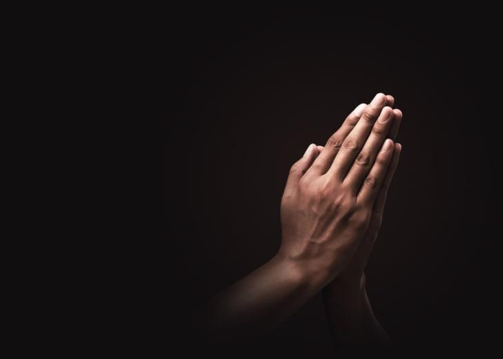 Hands held in prayer.