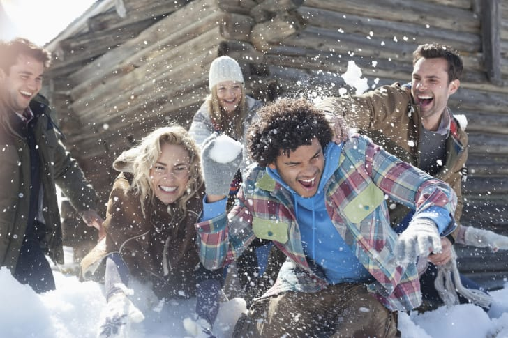 Kids having a snowball fight.