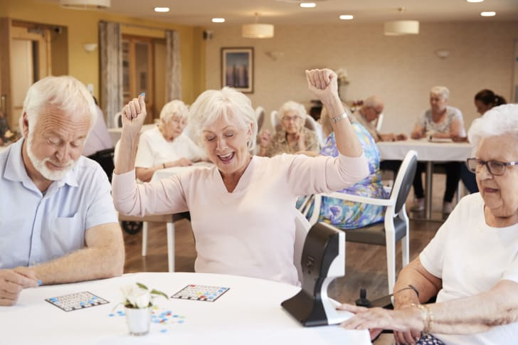 A group of senior citizens playing bingo.