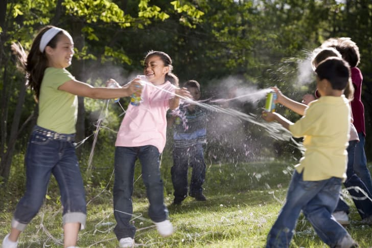 Children playing with Silly String.