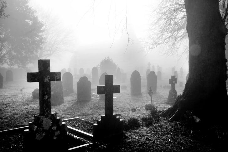 A photo of a foggy graveyard.