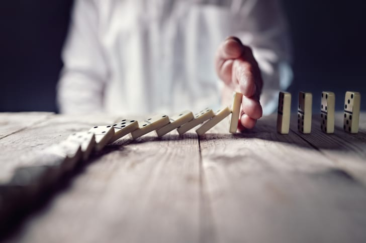 A man playing dominoes.