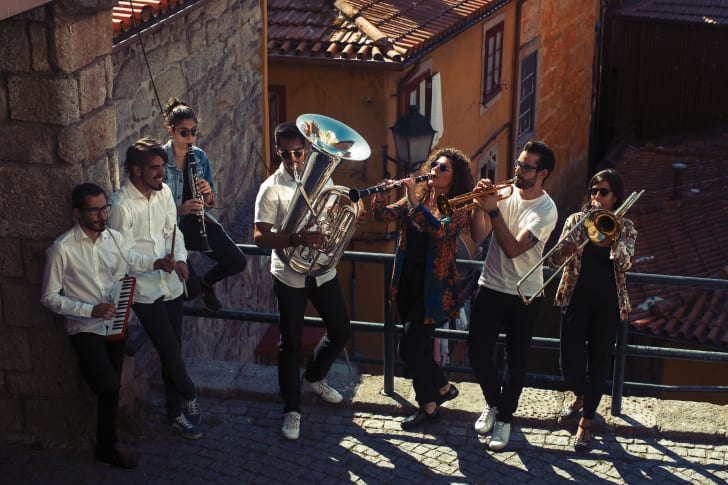 A jazz band plays on the streets of a city