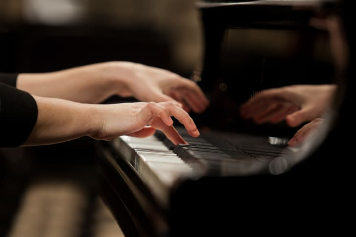 Girl's hands playing piano
