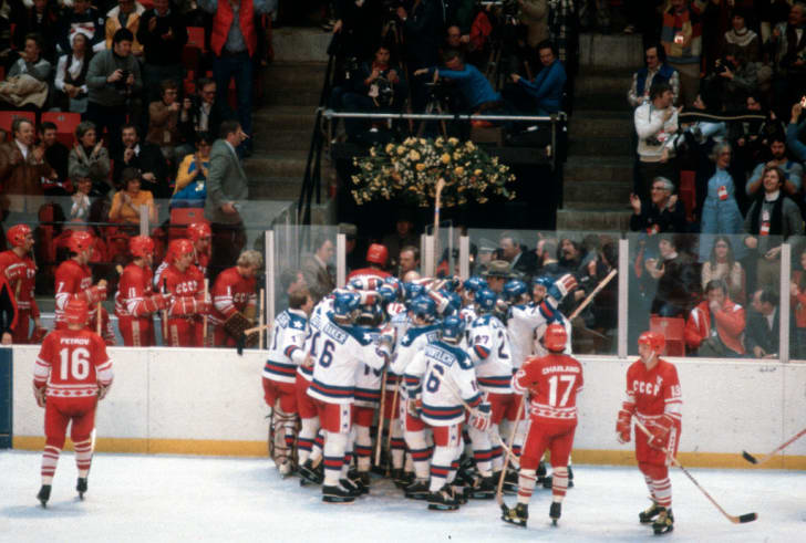 The United States Hockey team celebrates after they defeated the Soviet Union during a metal round game of the Winter Olympics February 22, 1980 at the Olympic Center in Lake Placid, New York