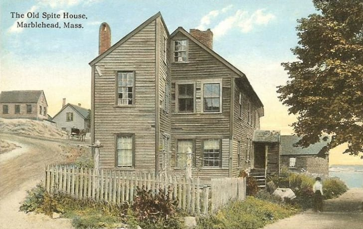 A vintage postcard of a wooden house
