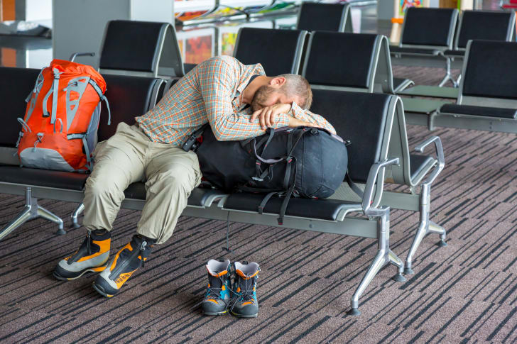 A customer sleeping in the airport.