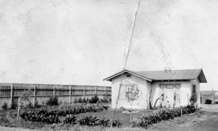 Black and white image of an old ranch