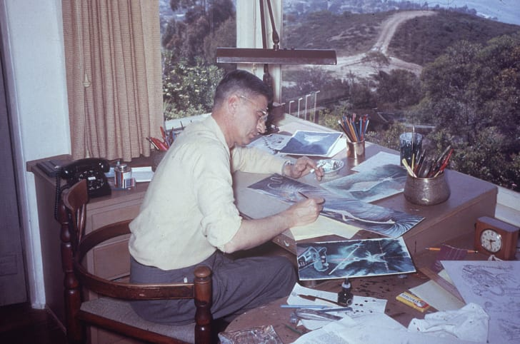 American author and illustrator Dr. Seuss (Theodor Seuss Geisel, 1904 - 1991), works on illustrations for one of his children's books at his desk at home in La Jolla, California, April 1957