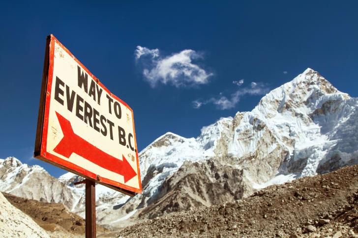 Nuptse peak near Gorak Shep village and signpost - Way to Everest base camp - Khumbu valley, Solukhumbu, Nepal Himalayas mountains