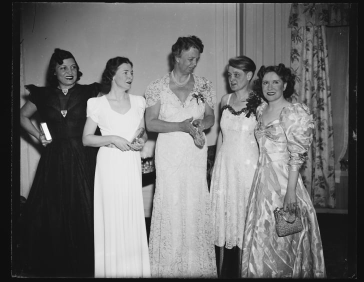 Black and white image of women in formal attire