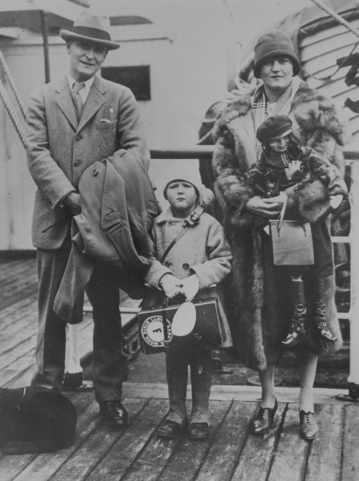Zelda Fitzgerald with her husband F. Scott Fitzgerald and daughter.