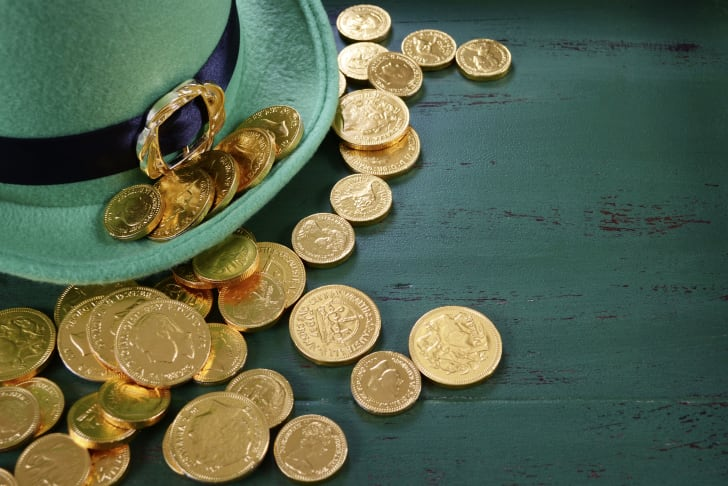 Leprechaun hat with gold chocolate coins on vintage style green wood