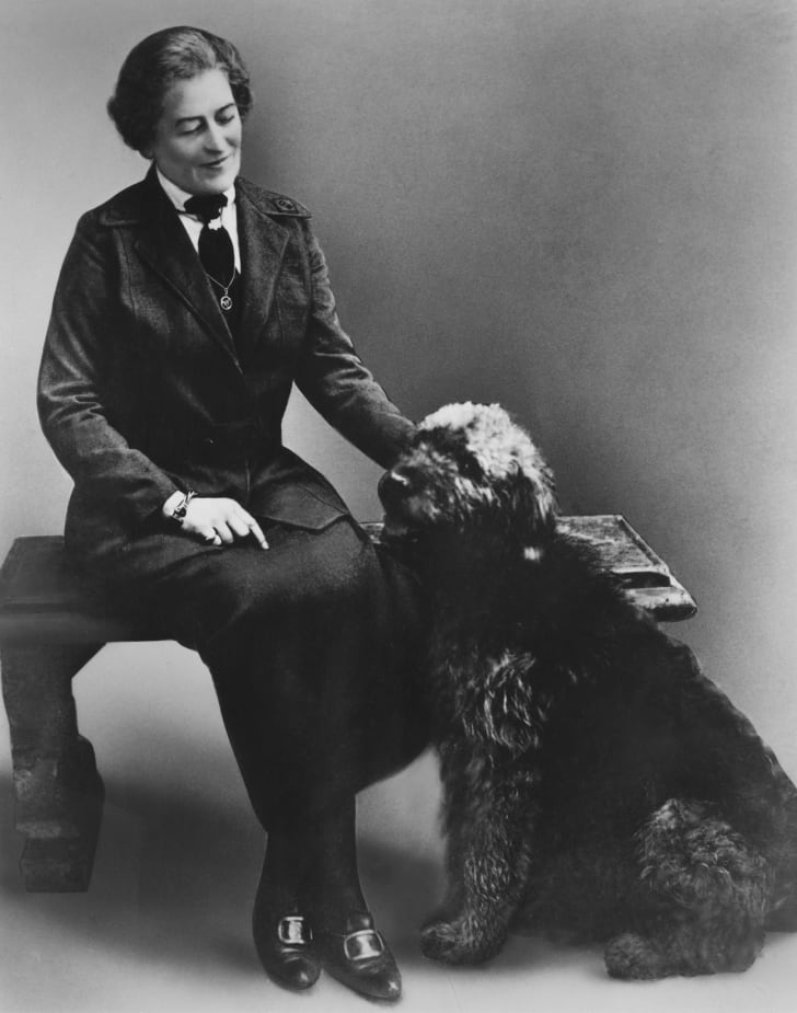 Juliette Gordon Low, founder of the Girl Scouts of the USA, with a dog, circa 1915.