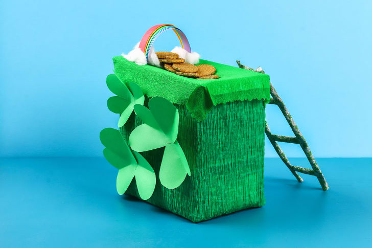 DIY leprechaun trap with gold coins, rainbow ,and green ladder