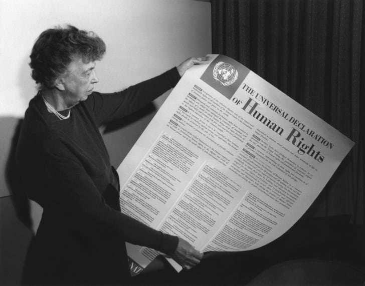 Eleanor Roosevelt holding a human rights declaration