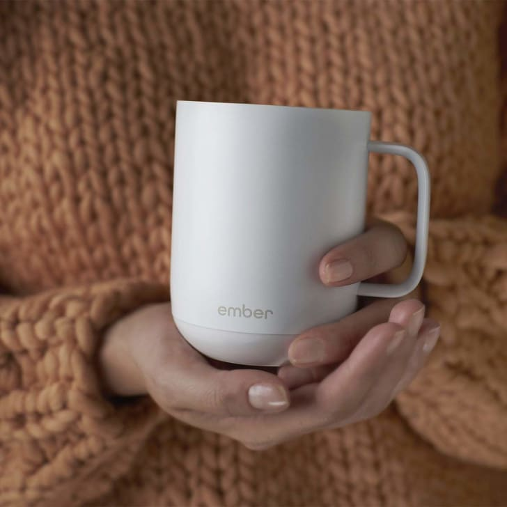 A smart coffee mug that keeps your drink warm.