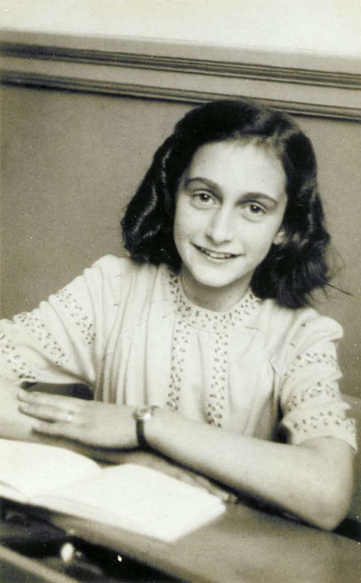 Anne Frank smiling for her school photograph in 1941