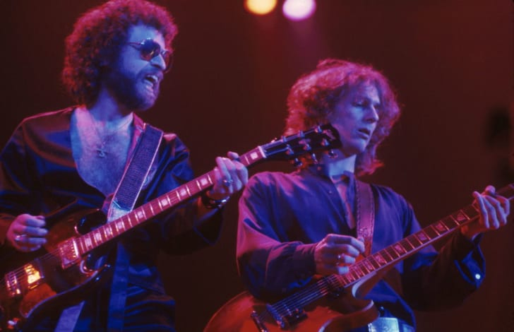 Eric Bloom and Allen Lanier from Blue Oyster Cult perform in 1977.
