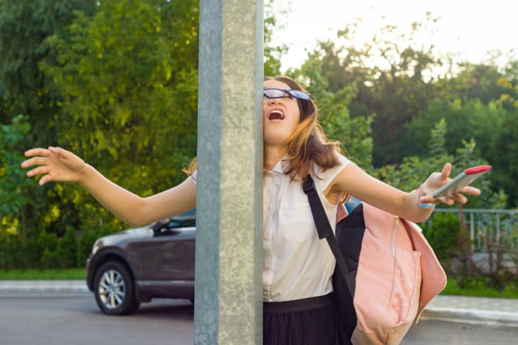 A distracted woman walks into a pole
