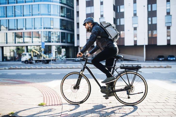 Man riding his bike.