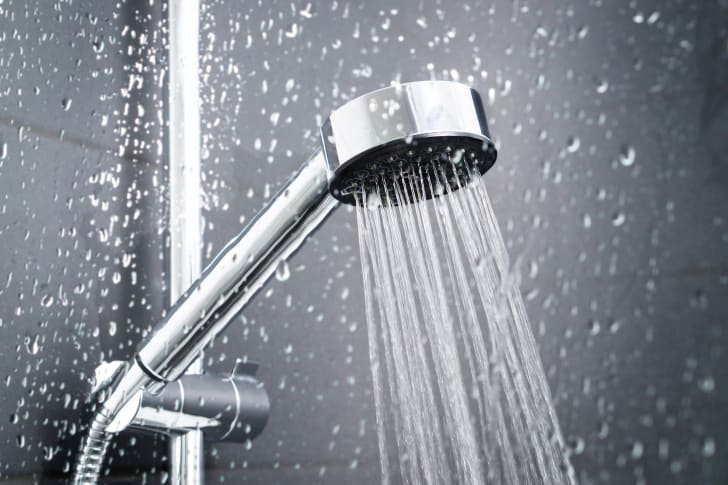 A shower head running water.