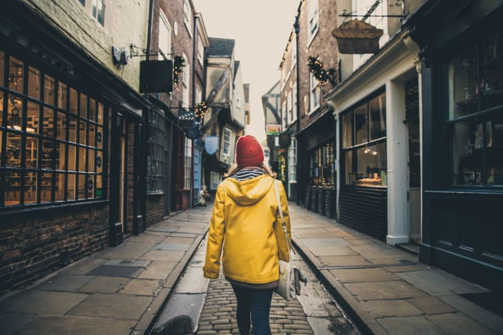 Woman walking alone in The Shambles in York, England