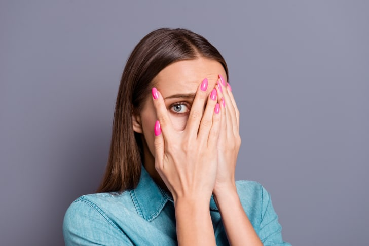 Close-up photo of embarrassed young woman