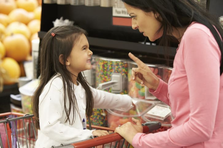Angry mother scolds disobedient child at store
