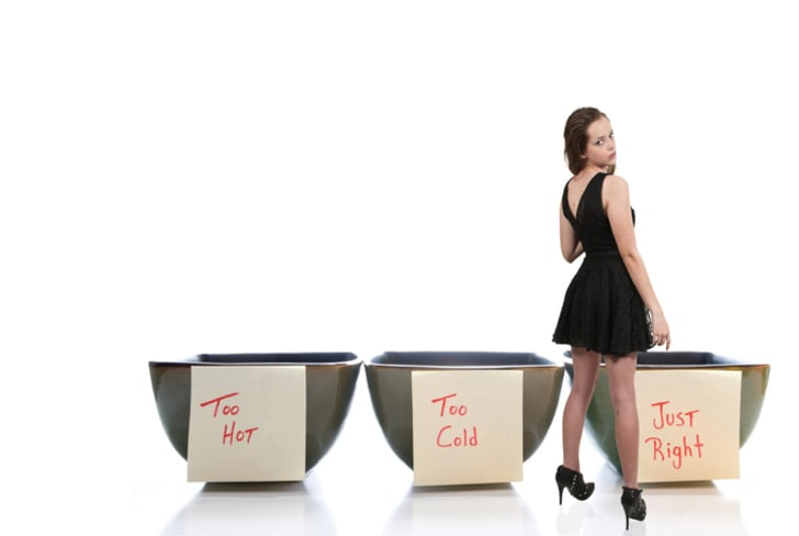 "Young woman stands in front of three bowls, one of which is ""just right"""