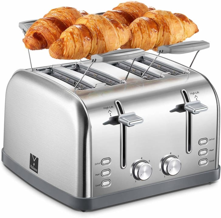 four-slice toaster with four croissants sitting on a warming tray