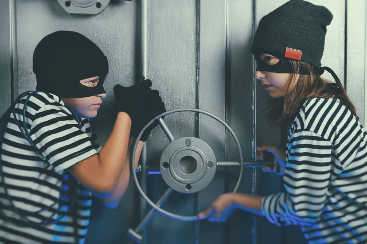 Two masked kids open a bank vault