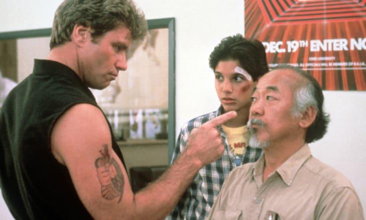 Martin Kove, Ralph Macchio, and Pat Morita in The Karate Kid (1984)