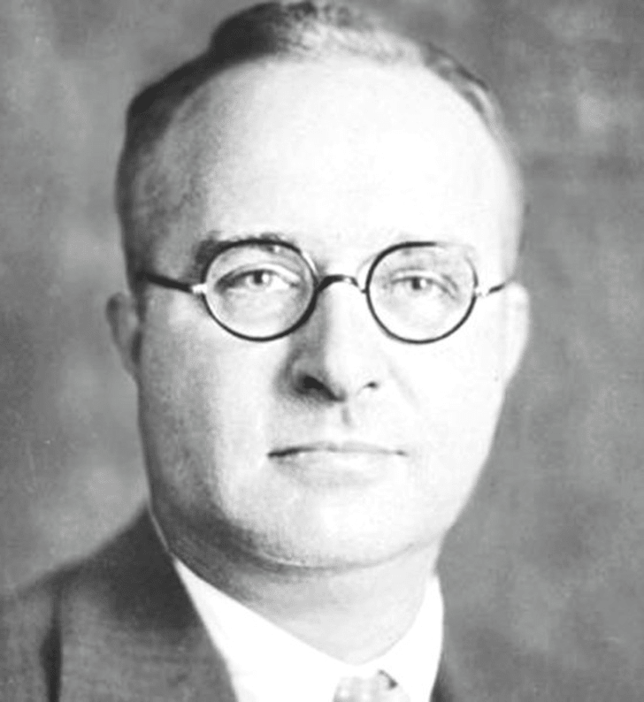 Black and white image of a man wearing glasses