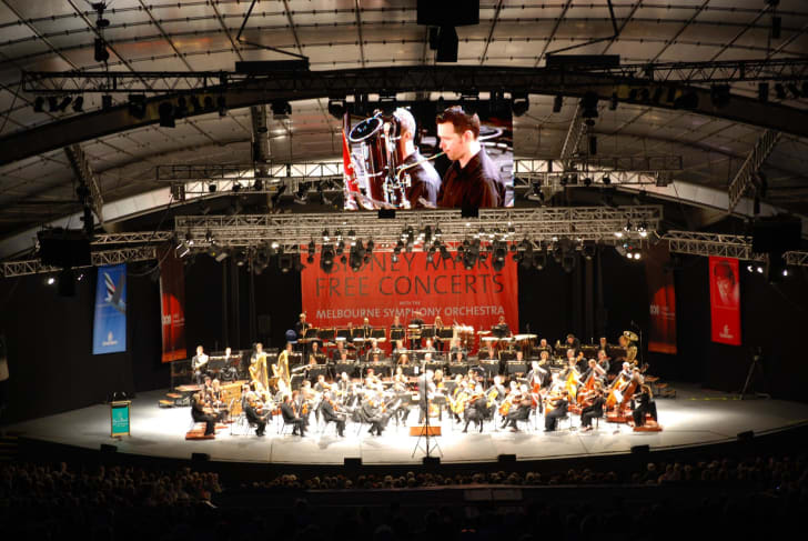 The Melbourne Symphony Orchestra performing on stage