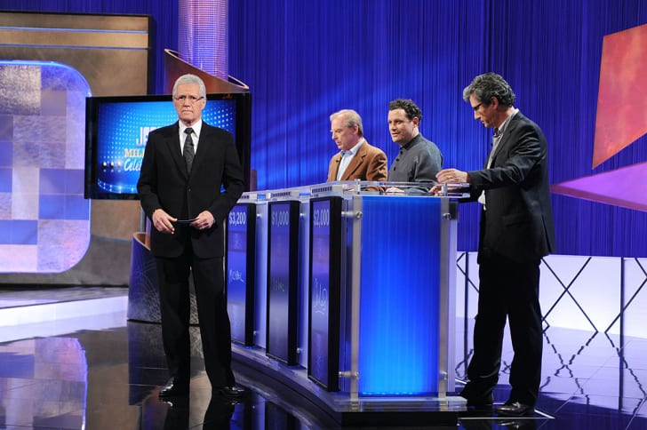Game show host Alex Trebek greets celebrity contestants Michael McKean, Isaac Mizrahi and Charles Shaughnessy on the set of the