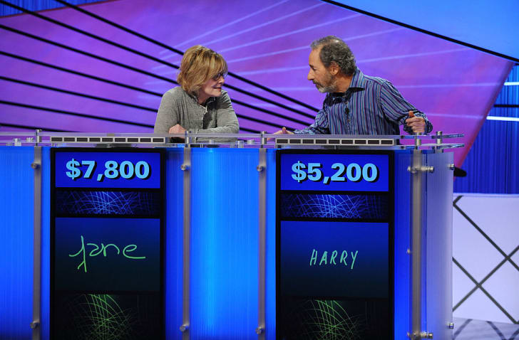 Celebrity contestants Jane Curtain and Harry Shearer pose on the set of the <em>Jeopardy!</em> Million Dollar Celebrity Invitational Tournament.