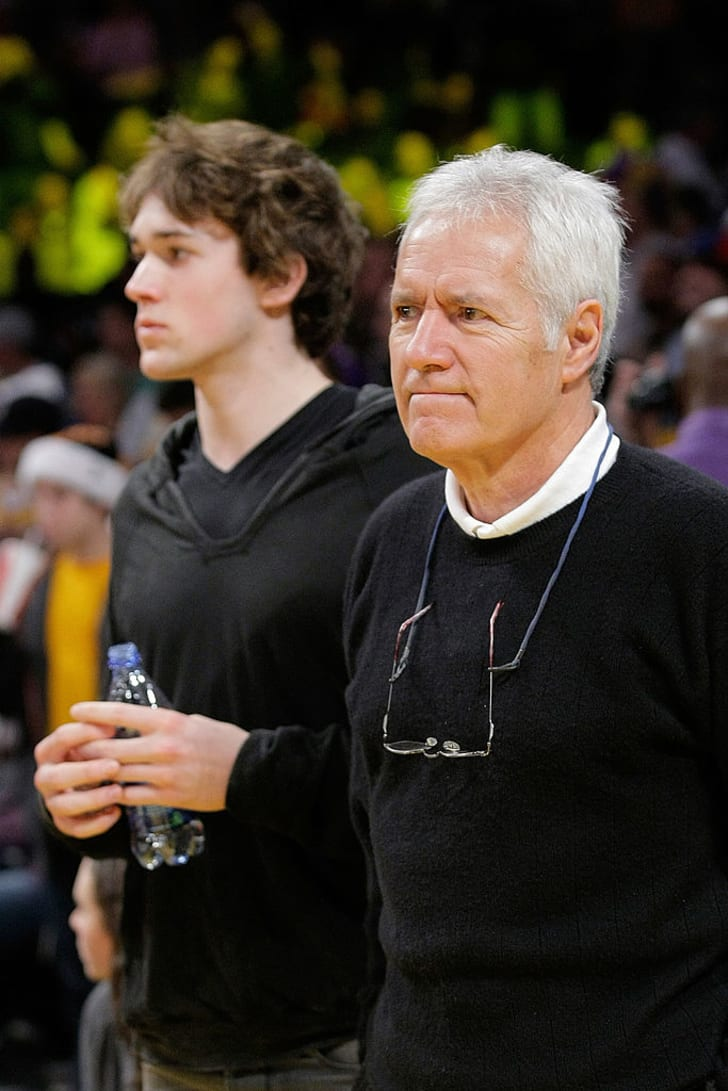 Alex Trebek and his son Matt attend a game between the Cleveland Cavaliers and the Los Angeles Lakers at Staples Center on December 25, 2009 in Los Angeles, California.