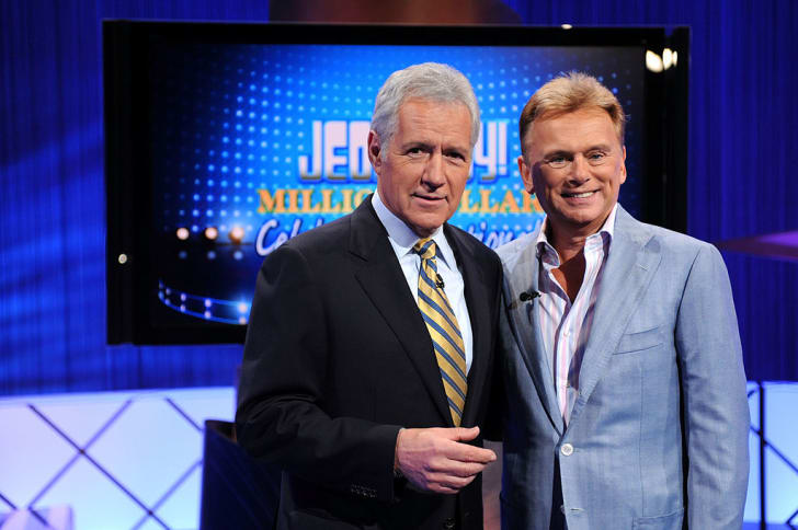 Game show hosts Alex Trebek (L) and Pat Sajak (R) pose on the set of the