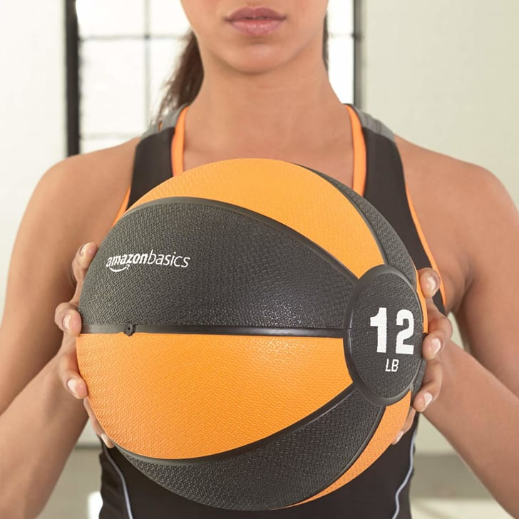 A woman working out with a medicine ball.