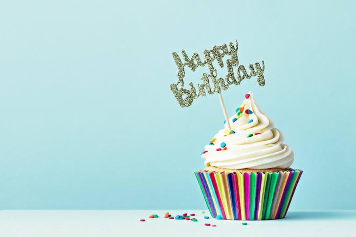 "A vanilla cupcake with ""happy birthday"" on it"