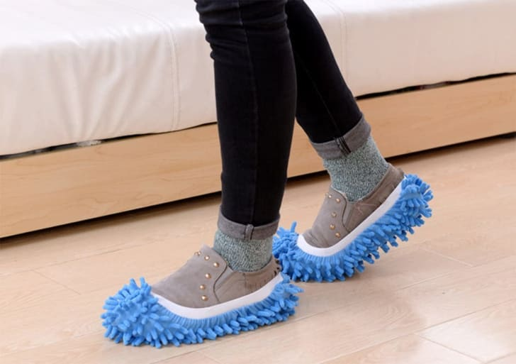 A person wearing mop slippers.